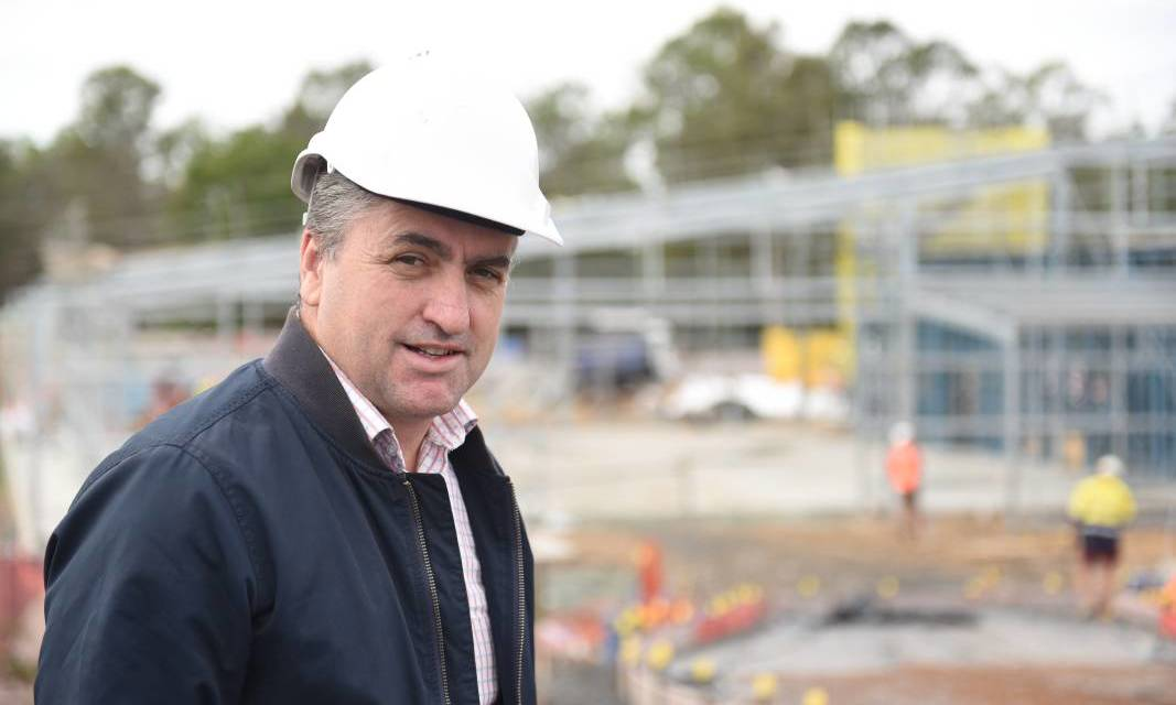 WIN FOR LOGAN: Logan MP Linus Power, pictured at the site of the new Munruben ambulance station, has praised the new state budget.